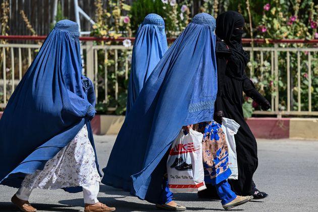Burqa clad Afghan women walk near the premises of Wazir Akbar Khan hospital in Kabul on September 1,...