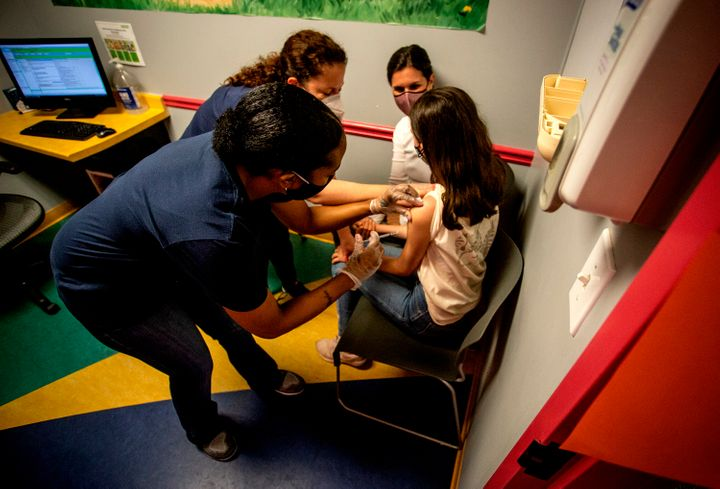 A middle school student receives her first coronavirus vaccination on May 12, 2021, in Decatur, Georgia. Hundreds of children, ages 12 to 15, received the Pfizer vaccine at the DeKalb Pediatric Center just days after it was approved for use within their age group.