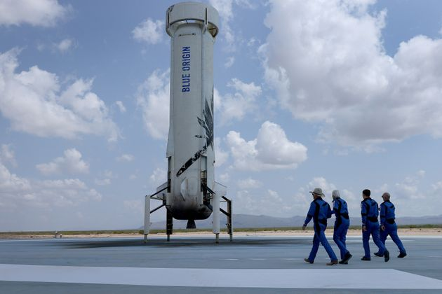 VAN HORN, TEXAS - JULY 20: Blue Origin's New Shepard crew (L-R) Jeff Bezos, Wally Funk, Oliver Daemen, and Mark Bezos walk near the booster to pose for a picture after flying into space in the Blue Origin New Shepard rocket on July 20, 2021 in Van Horn, Texas. Mr. Bezos and the crew were the first human spaceflight for the company. (Photo by Joe Raedle/Getty Images)