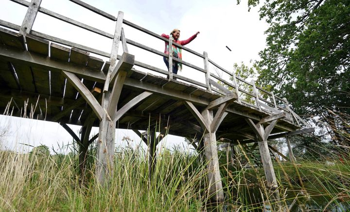 Silke Lohmann of Summers Place Auctions stands on the original Poohsticks Bridge from Ashdown Forest, featured in A.A. Milne'