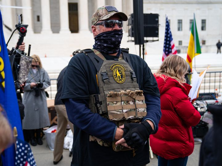 An Oath Keeper appears at a rally in front of the U.S. Supreme Court on Jan. 5.