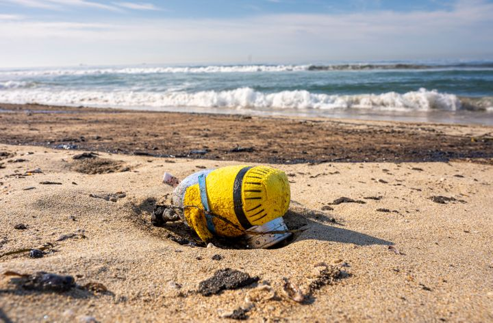 An oil soaked toy Minion washed up on shore at Huntington State Beach along with oil from a 126,000-gallon spill in Huntingto