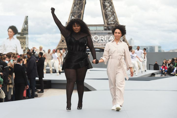 French singer/songwriter Yseult (L) presents a creation for L'Oreal on the sidelines of the Paris Fashion Week Spring-Summer 2022 Ready-to-Wear collection shows at the Trocadero, in Paris on Oct. 3.