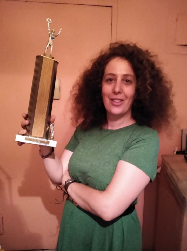The author in September with her last remaining trophy, which her parents found when moving out of the East 23rd Street apartment.