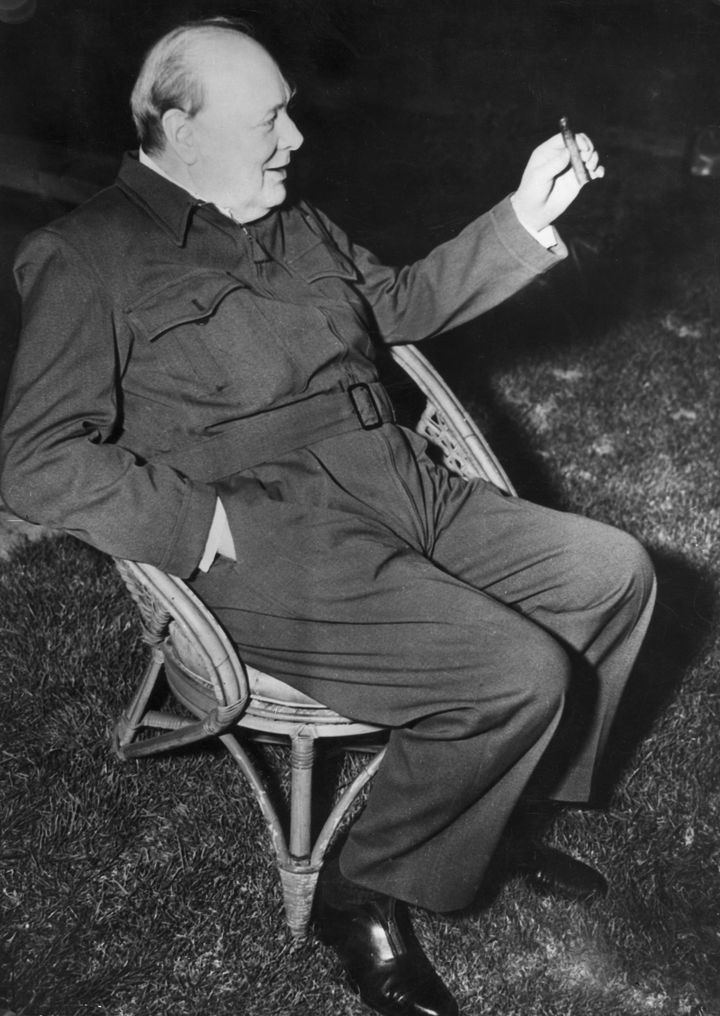 Churchill wears a siren suit as he relaxes in a garden chair during a visit to the U.S. in January 1942.