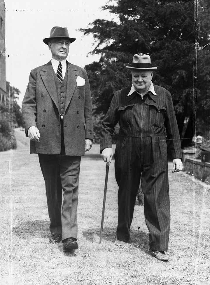 Churchill walks with the American financier and Presidential advisor Bernard Baruch on the grounds of his Kent home in July 1949.