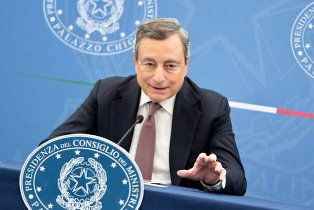 A handout photo made available by the Chigi Palace press office shows Italian Prime Minister Mario Draghi...