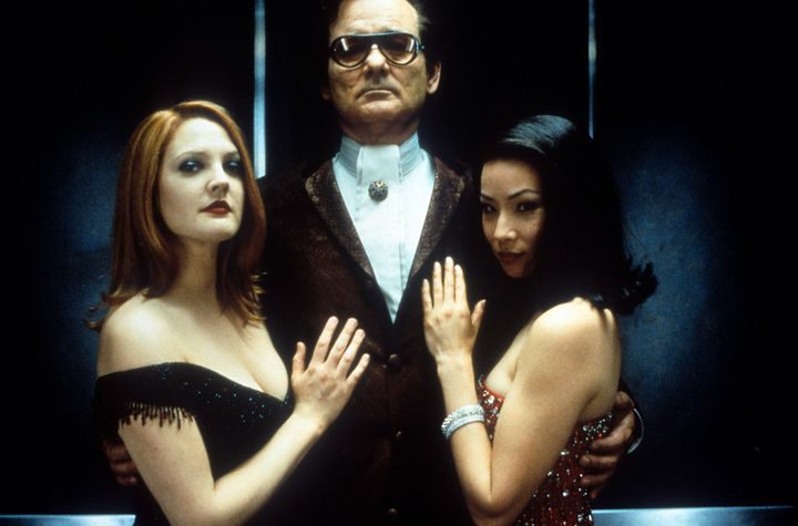 """Bill Murray holding Drew Barrymore and Lucy Liu in a publicity portrait for the film """"Charlie's Angels,"""" 2000."""