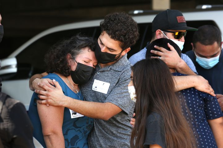 Mona Rodriguez's brother hugs her mother after a press conference on Oct. 1, 2021.