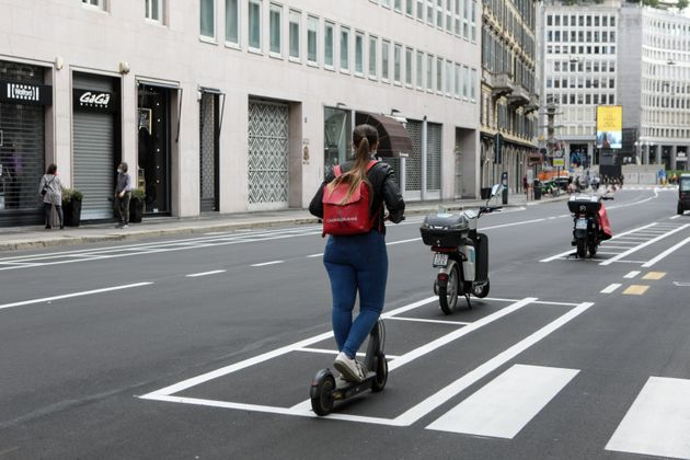 A girl goes on a scooter on the new San Babila cycle path in Milan, May 17 2020 (Photo by Mairo Cinquetti/NurPhoto...