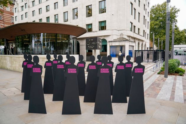 Silhouettes of women are placed outside New Scotland Yard by the British charity