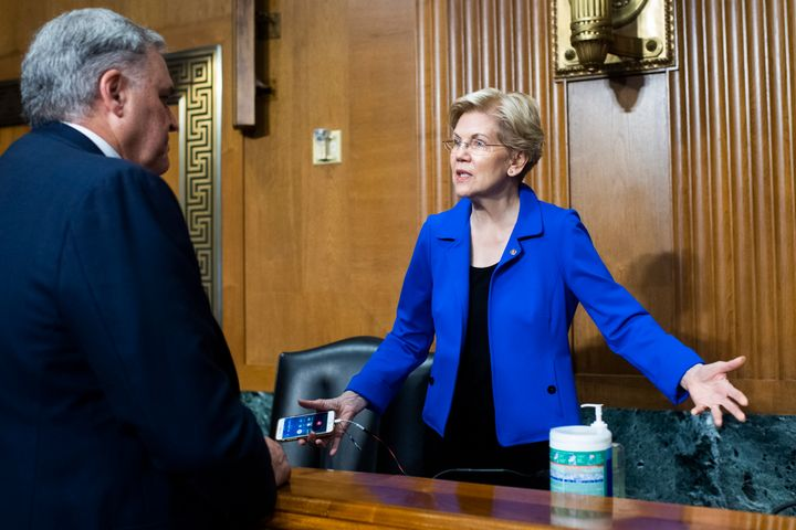 Rettig greets Sen. Elizabeth Warren (D-Mass.) before testifying during a June 8 Senate hearing on the IRS's 2022 budget request.