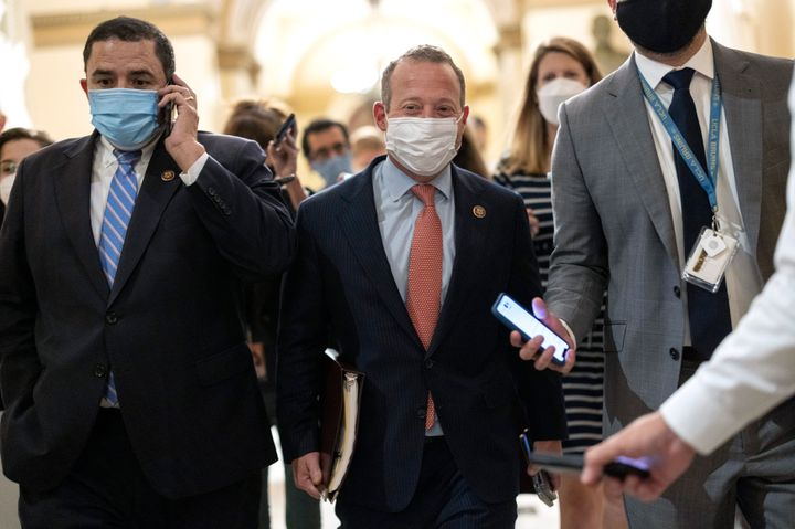Rep. Josh Gottheimer, a conservative New Jersey Democrat, center, has led efforts to decouple the bipartisan infrastructure bill from the budget reconciliation package.