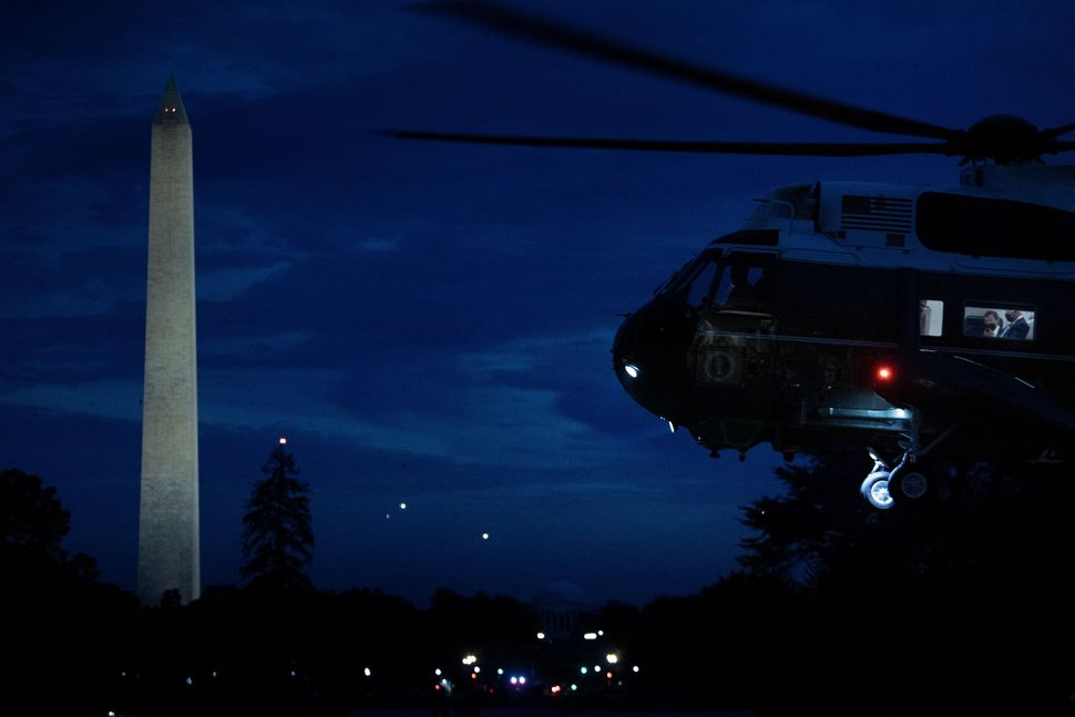President Joe Biden is seen with staff in Marine One as it lands on the South Lawn of the White House...