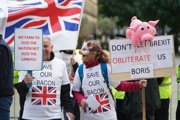 Pig farmers protesting outside the Conservative Party Conference in Manchester this