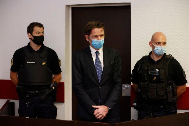 Rémy Daillet-Wiedemann, a former French politician whose popularity grew when he spread QAnon-style conspiracy theories, appears in court in Nancy, France on Wednesday, June 16, 2021, on charges he orchestrated the kidnapping of an 8-year-old girl whose mother had lost custody of her.