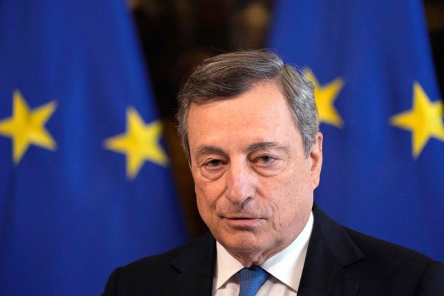 Italy's Prime Minister, Mario Draghi listens to questions during a joint press conference with the German...
