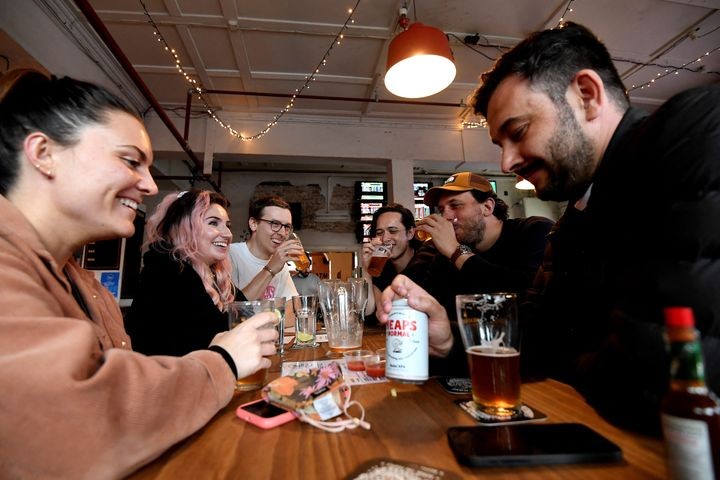 People enjoy their drinks at a pub on Oct.11, 2021, as Sydney ended their lockdown after 106 days and restaurants began throwing open their doors to anyone who could prove they were vaccinated.