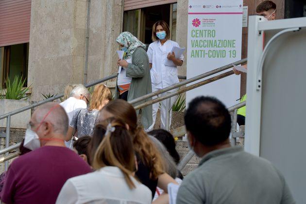 ROME, ITALY - SEPTEMBER 16:People waiting in line for the vaccine at the G. Eastman Hospital, Umberto...