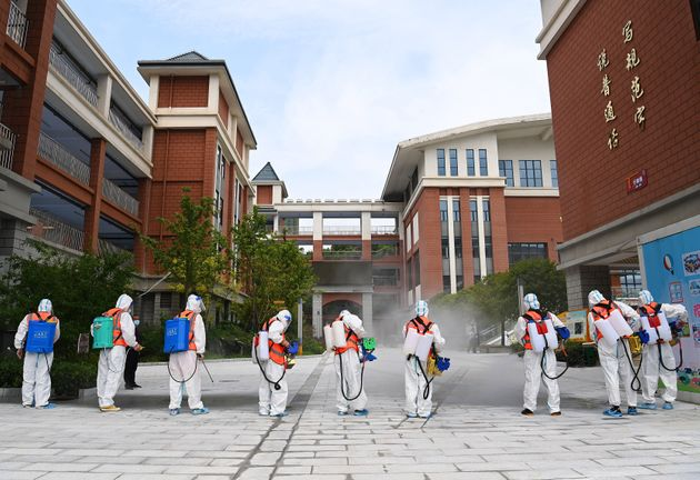 WUHAN, CHINA - AUGUST 25: Workers disinfect a primary school as new semester approaches on August 25,...