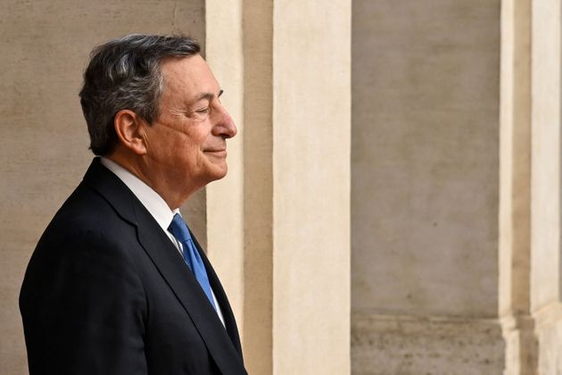 Italy's Prime Minister, Mario Draghi greets the German chancellor upon her arrival for their meeting...