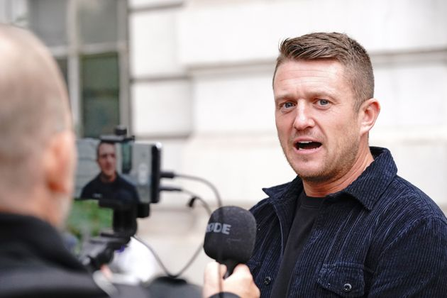 Tommy Robinson arrives at Westminster Magistrates' Court in London for a hearing regarding the stalking...
