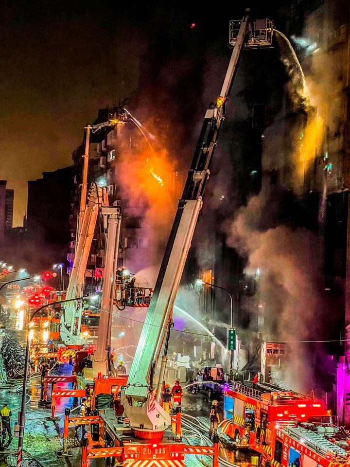 Firefighters battle a building fire in Kaohsiung, southern Taiwan, on Oct. 14, 2021.