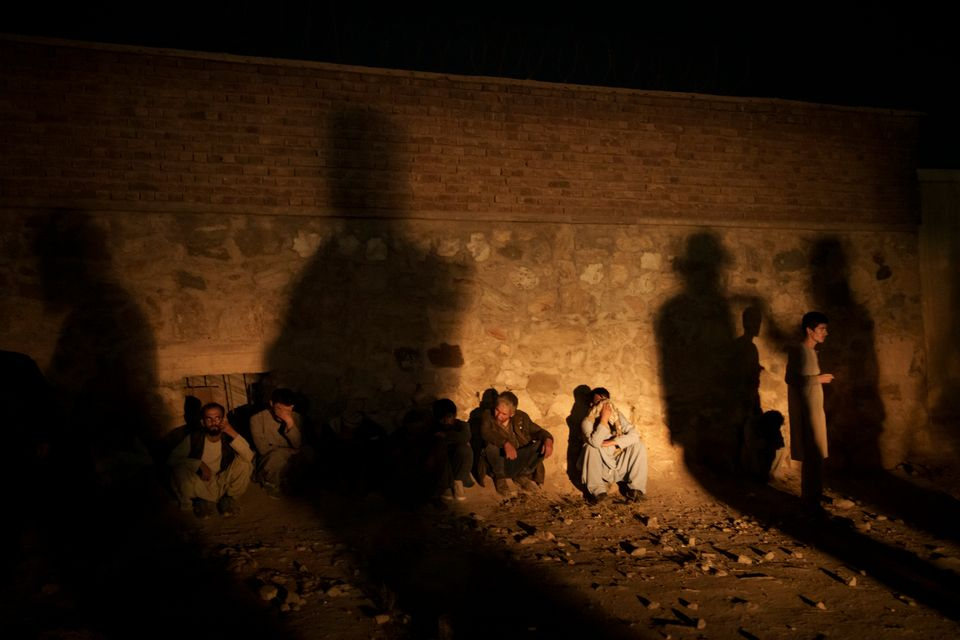 The shadow of Taliban fighters casts over drug users detained at a police station in Kabul, Afghanistan,...