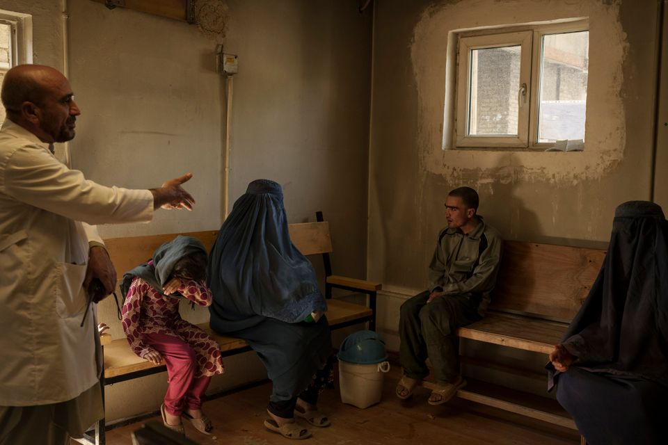 Dr. Wahedullah Koshan, left, gestures as he talks to Sitara, center, after she reunited with her 21-year-old...