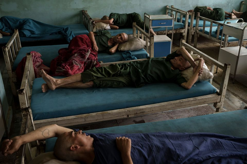 Drug users detained during a Taliban raid rest at the detoxification ward of the Avicenna Medical Hospital...