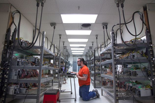 THE DALLES, OR - MARCH 12: Supervising technician Jeremy Bailey checks on equipment at OregonMines, a...