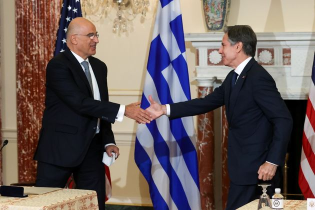 U.S. Secretary of State Antony Blinken and Greece's Foreign Minister Nikos Dendias shake hands after...