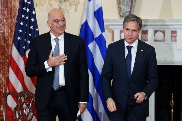 U.S. Secretary of State Antony Blinken and Greece's Foreign Minister Nikos Dendias depart after signing...