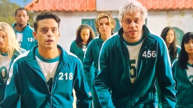Rami Malek, Pete Davidson Spoof 'Squid Game' In Bloody Country Music Video On 'SNL'.jpg