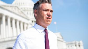 UNITED STATES - AUGUST 24: Rep. Jim Banks, R-Ind., a Navy Reserve officer who served in Afghanistan, arrives to a news conference to discuss the U.S. military withdrawal from the country, with members of the House Republican Conference outside of the U.S. Capitol on Tuesday, August 24, 2021. Current members of Congress who served in Afghanistan attended the event. (Photo By Tom Williams/CQ-Roll Call, Inc via Getty Images)