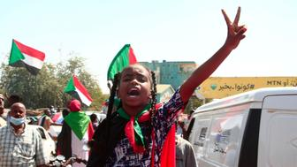 A young Sudanese girl takes part in a demonstration in Omdurman, the capital Khartoum's twin city, to demand the government's transition to civilian rule, on October 21, 2021. - Supporters of Sudan's transitional government took to the streets of the capital today as rival demonstrators kept up a sit-in demanding a return to military rule. The mainstream faction backs the transition to civilian rule, while supporters of the breakaway faction are demanding the military take over. (Photo by Ebrahim HAMID / AFP) (Photo by EBRAHIM HAMID/AFP via Getty Images)